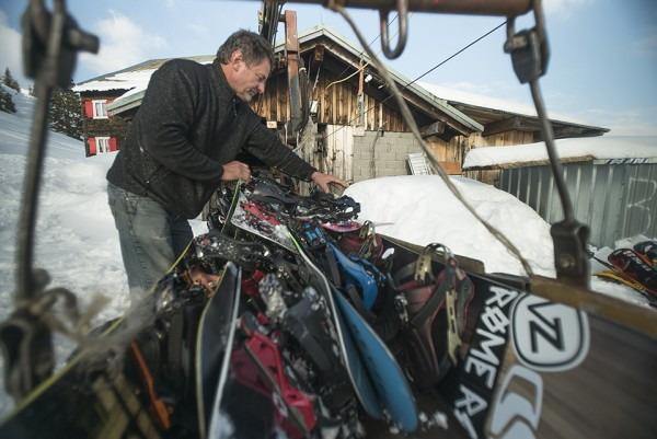 Gigi Rüf's uncle loads up the rickety gondola outside his mountain cafe